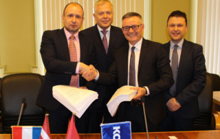 contract signing in Liepaja, Latvia